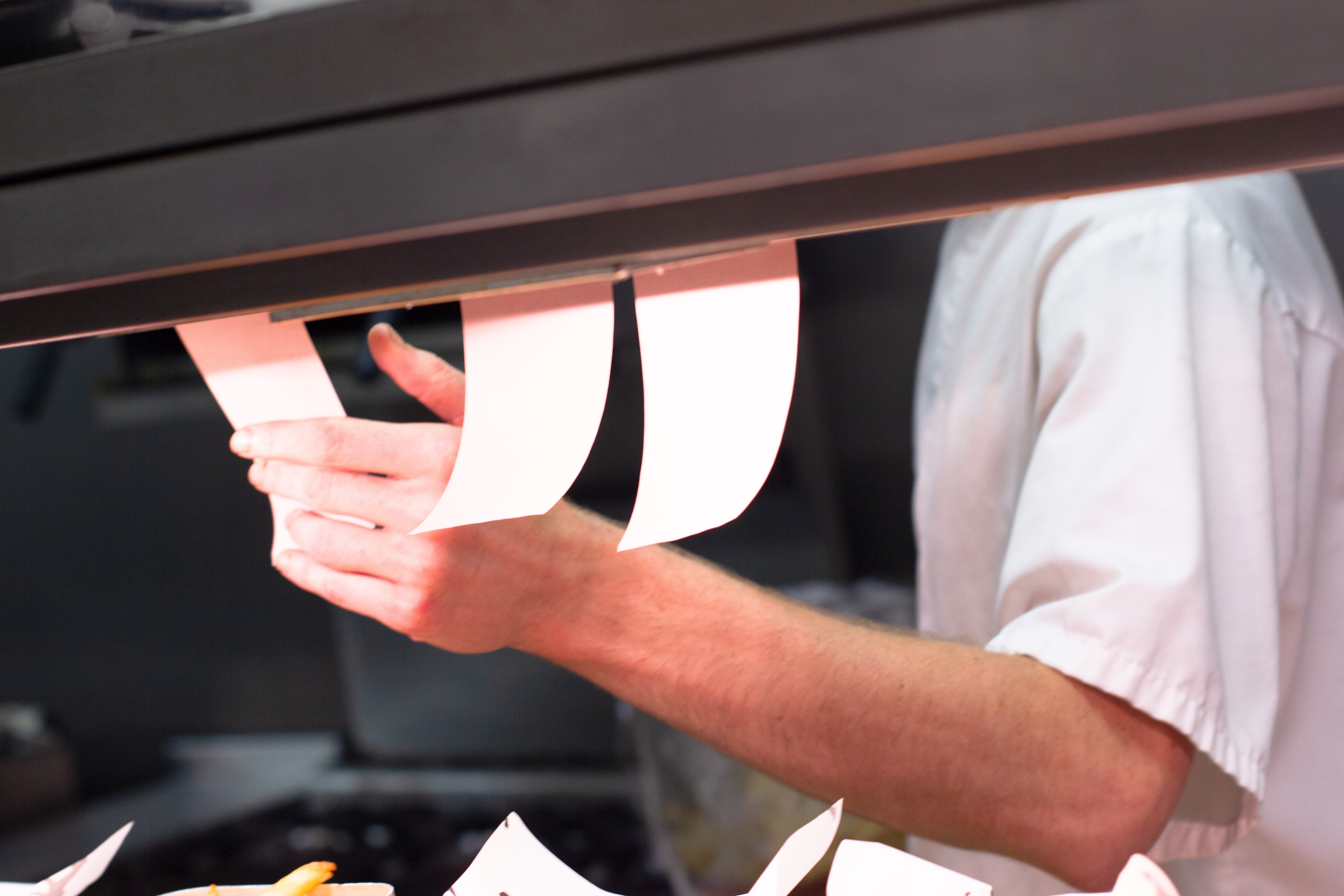 Kitchen staff checking order receipts