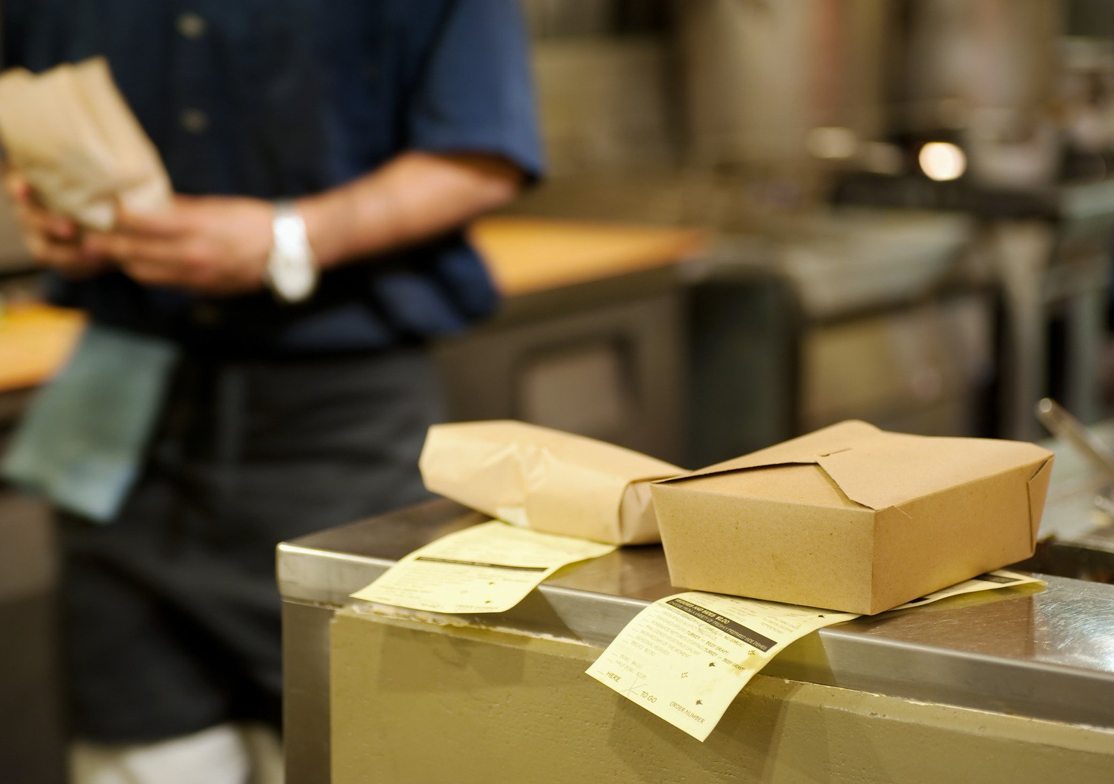 Takeout boxes and receipts in the kitchen